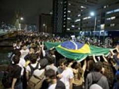 More than 200,000 protesters take to the streets of Brazil to protest the billions spent on hosting the 2014 World Cup