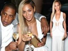 beyoncé shows some skin in knit dress as she clinks champagne flutes with jay-z at his 40/40 tenth anniversary party