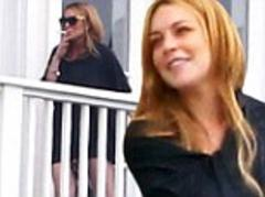 Lindsay Lohan looks happy and relaxed as she smokes a cigarette with her new friends at rehab